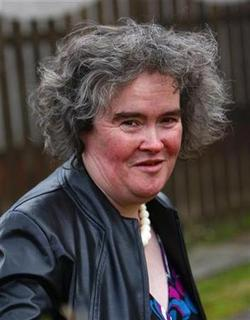 ''Britain's Got Talent'' contestant Susan Boyle returns to her home in Blackburn in West Lothian, Scotland April 21, 2009. REUTERS/David Moir
