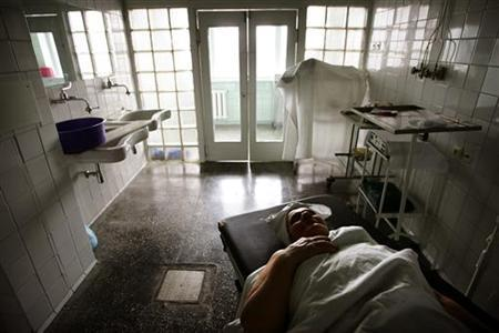 A Ukrainian woman waits to be operated upon for thyroid cancer at the surgery section in a hospital in Kiev April 6, 2006. REUTERS/Damir Sagolj