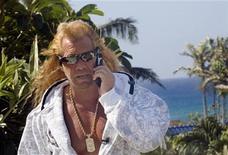 "<p>Duane ""Dog"" Chapman speaks on a phone in Honolulu, Hawaii January 16, 2007. REUTERS/Lucy Pemoni</p>"