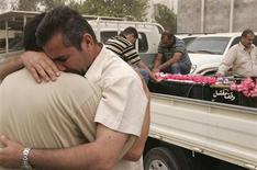 <p>Mourners grieve during the funeral of their relative who was killed in a bomb attack in Baghdad April 24, 2009. REUTERS/Mohammed Ameen</p>