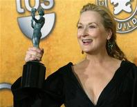 "<p>Meryl Streep holds up her award for Outstanding Performance by a Female Actor in a Leading Role for ""Doubt"" at the 15th annual Screen Actors Guild Awards in Los Angeles January 25, 2009. REUTERS/Danny Moloshok</p>"