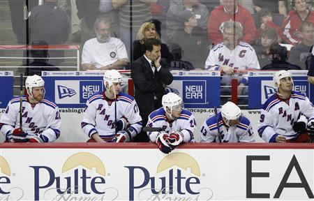 New York Rangers head coach John Tortorella watches the closing seconds of their game against the Washington Capitals in Game 5 of their NHL Eastern Conference quarter-final hockey series in Washington April 24, 2009. REUTERS/Molly Riley