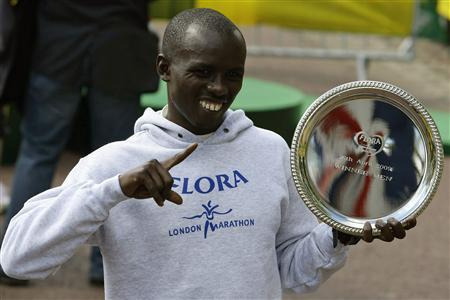 Kenya's Sammy Wanjiru poses with his trophy after winning the 2009 men's elite event in the London Marathon April 26, 2009. REUTERS/Stefan Wermuth