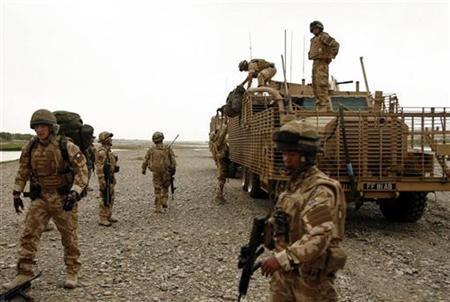 British soldiers patrol in Musa Qala, Helmand province. March 28,2009. REUTERS/Omar Sobhani