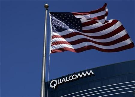 The U.S. flag flies next to one of Qualcomm's many buildings in San Diego, California, July 22, 2008. REUTERS/Mike Blake