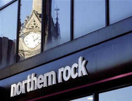 Buildings are reflected in the windows of Northern Rock's Leicester branch, central England in this February 4, 2008 file photograph. REUTERS/Darren Staples/Files