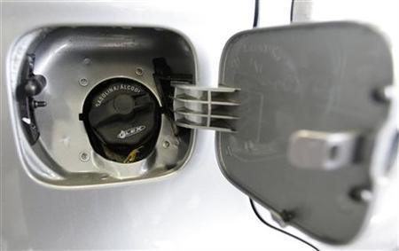The gas cap of a car that can run on either gasoline or ethanol is pictured at a showroom in Rio de Janeiro April 30, 2008. REUTERS/Sergio Moraes
