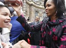 <p>President Obama and first lady Michelle Obama shake hands with people at Palais Rohan in Strasbourg, France, April 3, 2009. REUTERS/Christian Hartmann</p>