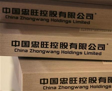 IPO brochures of China Zhongwang Holdings Limited are displayed at a news conference in Hong Kong April 23, 2009. The initial public offering is the biggest test of investor appetite for new listings since last year's market meltdown. REUTERS/Bobby Yip (CHINA BUSINESS)