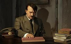 <p>A wax figure of Adolf Hitler is pictured in a mock bunker at the German 'Madame Tussauds' in Berlin, in this file photo from July 3, 2008.REUTERS/Tobias Schwarz</p>