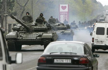Tanks roll down a street as they leave the Mukhrovani army base after putting down a mutiny, some 10 km east of Tbilisi May 5, 2009. REUTERS/David Mdzinarishvili