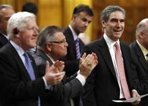 <p>Liberal leader Michael Ignatieff (R) receives a standing ovation from his caucus while speaking during Question Period in the House of Commons on Parliament Hill in Ottawa May 4, 2009. REUTERS/Chris Wattie</p>