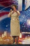"<p>Scottish singer Susan Boyle is seen performing during a rehearsal of ""Britain's Got Talent"", in Glasgow, Scotland, in this undated handout photograph received in London on April 20, 2009. REUTERS/Ken McKay/talkbackTHAMES/Handout</p>"