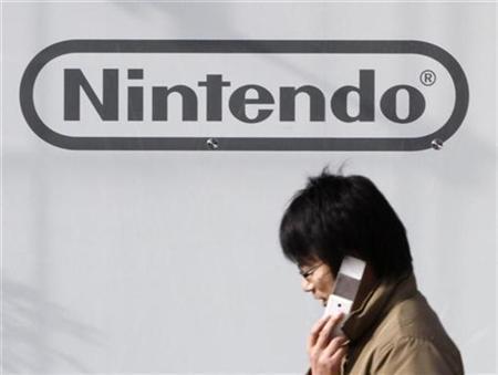 A man walks past a Nintendo Co Ltd's showroom in Tokyo January 29, 2009. REUTERS/Toru Hanai