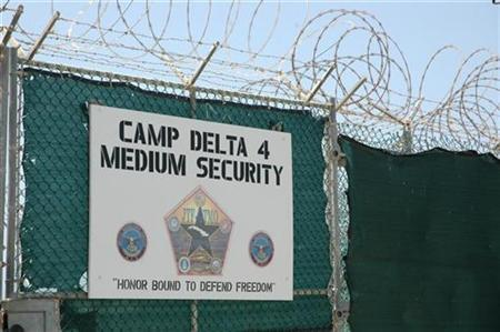 A sign states the presence of Camp Delta, the detention complex for terrorism suspects, at the U.S. Naval Base at Guantanamo Bay, Cuba on July 23, 2008. REUTERS/Randall Mikkelsen