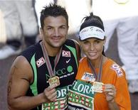 <p>Model Katie Price and Peter Andre hold up their medals after finishing the 2009 London Marathon, April 26, 2009. REUTERS/Stefan Wermuth</p>