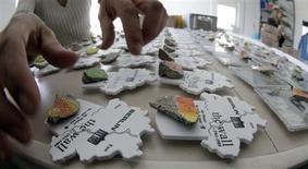 <p>A worker sorts Berlin Wall souvenirs at the company of Volker Pawlowski, a 52-year-old businessman who runs his own Berlin Wall souvenir company, in Berlin April 17, 2009. REUTERS/Tobias Schwarz</p>