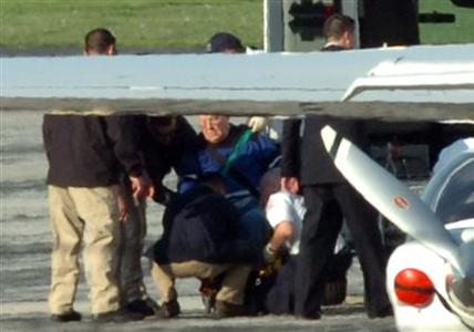 Suspected Nazi death camp guard John Demjanjuk, 89, is taken from an ambulance and placed on a jet at Burke Lakefront Airport in Cleveland, Ohio May 11, 2009. REUTERS/Ron Kuntz