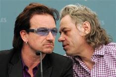 <p>U2 lead singer Bono (L) and Make Poverty History organiser Bob Geldof confer during their final news conference at the G8 summit in Gleneagles, Scotland, July 8, 2005. REUTERS/Arnd Wiegmann</p>