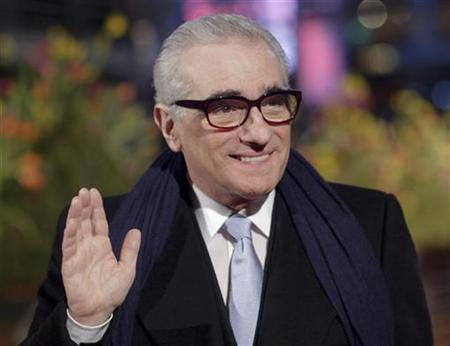 U.S. director Martin Scorsese waves at the red carpet as he arrives for the screening of his opening film 'Shine A Light' running in competition at the 58th Berlinale International Film Festival in Berlin February 7, 2008. REUTERS/Hannibal Hanschke