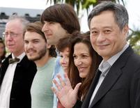"<p>Director Ang Lee (R) poses with producer Celia Costas (2nd R) and cast members James Schamus, Emile Hirsch, Demetri Martin and Imelda Staunton (L-R) during a photocall for the film ""Taking Woodstock"" at the 62nd Cannes Film Festival May 16, 2009. REUTERS/Eric Gaillard</p>"