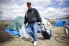 <p>Jim Gibson leaves his tent for the day at a homeless tent city in Sacramento, California in this March 15, 2009 file photo. REUTERS/Max Whittaker/Files</p>