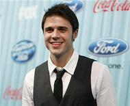 "<p>Kris Allen poses at the party for the 12 finalists of the television show ""American Idol"" in Los Angeles March 5, 2009. REUTERS/Mario Anzuoni</p>"