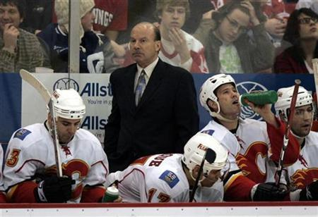 In this file photo Calgary Flames head coach Mike Keenan stands behind the bench in Detroit, Michigan December 10, 2008. REUTERS/Rebecca Cook