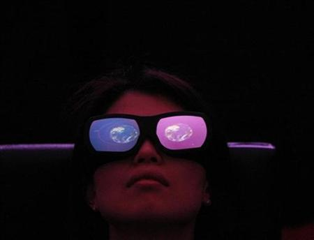 The image of earth is reflected in a pair of 3D glasses as a woman watches a three dimensional projection in the planetarium ''Atmos'' during its photo opportunity at the National Museum of Emerging Science and Innovation (Miraikan) in Tokyo January 14, 2009. REUTERS/Kim Kyung-Hoon