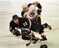 <p>Vancouver Canucks' Peter Zezel (L) is tripped up by Boston Bruins' Sergei Samsonov (R) during the first period of their NHL game in Boston, December 1, 1998. Zezel has died at 44 after complications from a blood disorder that ailed him for years, the NHL players' association (NHLPA) said. REUTERS/Brian Snyder</p>