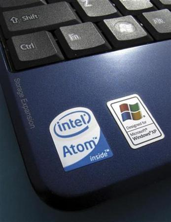 An Intel Inside sticker is shown next to a Windows XP sticker on an Acer Netbook in Encinitas, California April 13, 2009. REUTERS/Mike Blake