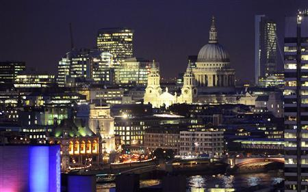 St Paul's Cathedral and areas of the financial district of the City of London are seen at dusk October 9, 2008. REUTERS/Toby Melville