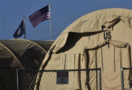 In this photo, reviewed by the U.S. Military, an American flag flies at Camp Justice, the location of the U.S. Military Commissions court for war crimes, at the U.S. Naval Base, in Guantanamo Bay, Cuba, January 19, 2009. REUTERS/Brennan Linsley/Pool