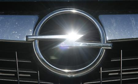 An Opel logo is pictured at a car at Opel dealer in Bochum May 29, 2009. REUTERS/Ina Fassbender