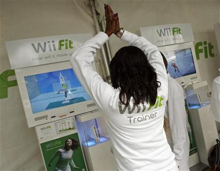 A woman demonstrates an interactive yoga game on Nintendo's Wii Fit, a new interactive fitness game for Wii system, during the product launch in New York May 19, 2008. REUTERS/Shannon Stapleton