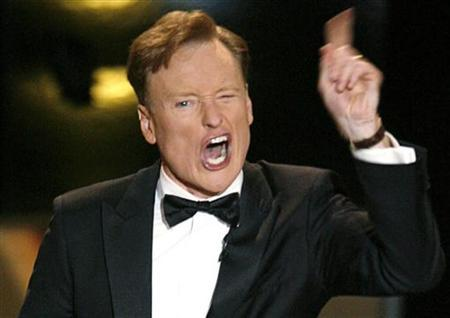 Host Conan O'Brien gestures onstage during the 58th annual Primetime Emmy Awards at the Shrine Auditorium in Los Angeles in this August 27, 2006 file photo. REUTERS/Mike Blake/Files