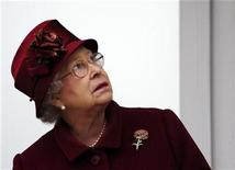 <p>The Queen watches the first race on the final day of the Cheltenham Festival horse racing meeting in Gloucestershire, in this file photo from March 13, 2009. REUTERS/Dylan Martinez</p>