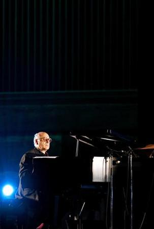 British composer Michael Nyman performs onstage during the Live Earth special concert at Toji temple in Kyoto, July 7, 2007. REUTERS/Kiyoshi Ota