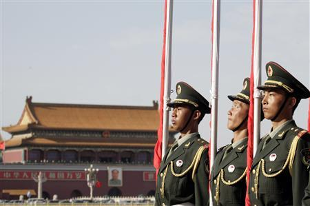 Chinese soldiers carry red flags during a welcoming ceremony for Malaysia's Prime Minister Najib Razak outside the Great Hall of the People at Tiananmen Square in Beijing June 3, 2009. Chinese security forces blanketed Tiananmen Square on Wednesday ahead of the 20th anniversary of the June 4 crackdown on pro-democracy protesters, a day after Twitter and Hotmail Internet services in China were blocked. REUTERS/Reinhard Krause