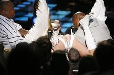 <p>Sacha Baron Cohen, wearing a jockstrap and wings, lands on Eminem's head as bodyguards try to remove him at the 2009 MTV Movie Awards in Los Angeles, May 31, 2009. REUTERS/Mario Anzuoni</p>