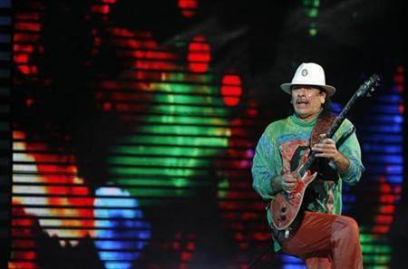Mexican guitarist Carlos Santana performs during the 50th International Song Festival in Vina Del Mar city, about 75 miles (120 km) northwest of Santiago February 25, 2009. REUTERS/Eliseo Fernandez