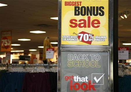 Signs announce a sale for ''back to school'' at a JC Penney Co store in Westminster, Colorado August 14, 2008. REUTERS/Rick Wilking (UNITED STATES)