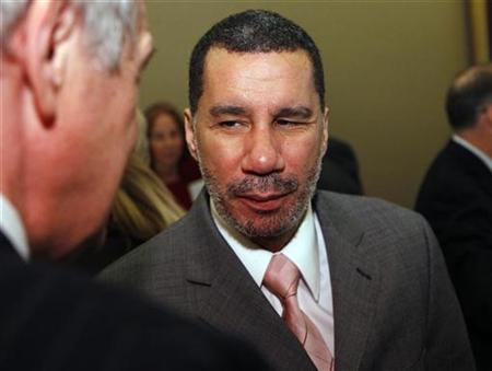 New York Governor David Paterson (R) speaks to friends before he and New Jersey Governor Jon Corzine (not pictured) discuss the economy at a luncheon hosted by Harvard University's John F. Kennedy School of Government, in New York, in this February 19, 2009 file photo. REUTERS/Chip East