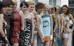 <p>Models wear leather dress by German designer Daniel Rodan during a promotion for the 'Mauerkleider - East Side Gallery goes Fashion' in Berlin, June 9, 2009. Berlin leather fashion designer to the stars Rodan unveiled a new collection of Berlin Wall art-themed clothing on Tuesday as part of the 20th anniversary celebrations of the fall of the wall. The leather dresses and frocks feature iconic wall art from the East Side Gallery, the 1,300 metre-long stretch of the Wall painted by 118 artists from 21 countries in 1990, and whose designs quickly came to symbolize the Wall itself. REUTERS/Tobias Schwarz</p>