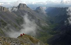 <p>People walk on a cliff overlooking Ram Plateau in the Nahanni National Park Reserve, Northwest Territories in this undated handout photo released June 9, 2009. REUTERS/Mike Beedell/Parks Canada Agency/Handout</p>