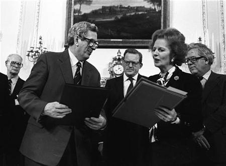 Then Irish Prime Minister Garret Fitzgerald and then British Prime Minister Margaret Thatcher exchange documents after signing an Anglo-Irish agreement at Hillsborough House on November 15, 1985. Reuters/Rob Taggart
