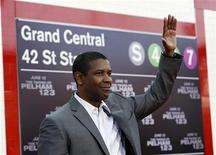 "<p>Cast member Denzel Washington waves at the premiere of the movie ""The Taking of Pelham 1 2 3"" at the Mann Village theatre in Los Angeles June 4, 2009. The movie opens in the U.S. on June 12. REUTERS/Mario Anzuoni</p>"