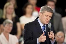 <p>Canada's Prime Minister Stephen Harper outlines his government's progress on their economic action plan during a town hall meeting at the Armenian Community Centre in Cambridge, Ontario, June 11, 2009. REUTERS/Geoff Robins</p>