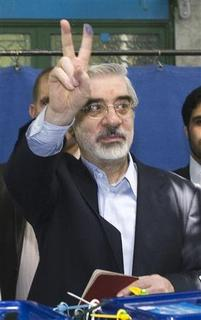 Presidential candidate Mirhossein Mousavi flashes a victory sign after casting his vote during the Iranian presidential election in southern Tehran June 12, 2009. REUTERS/Raheb Homavandi