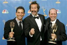 "<p>Jason Lee (C), lead actor of ""My Name is Earl"", stands with Marc Buckland (L) who is holding his Emmy for outstanding director for a comedy series and Greg Garcia who is holding his Emmy for outstanding writer for a comedy series during the 58th annual Primetime Emmy Awards at the Shrine Auditorium in Los Angeles August 27, 2006. REUTERS/Mario Anzuoni</p>"